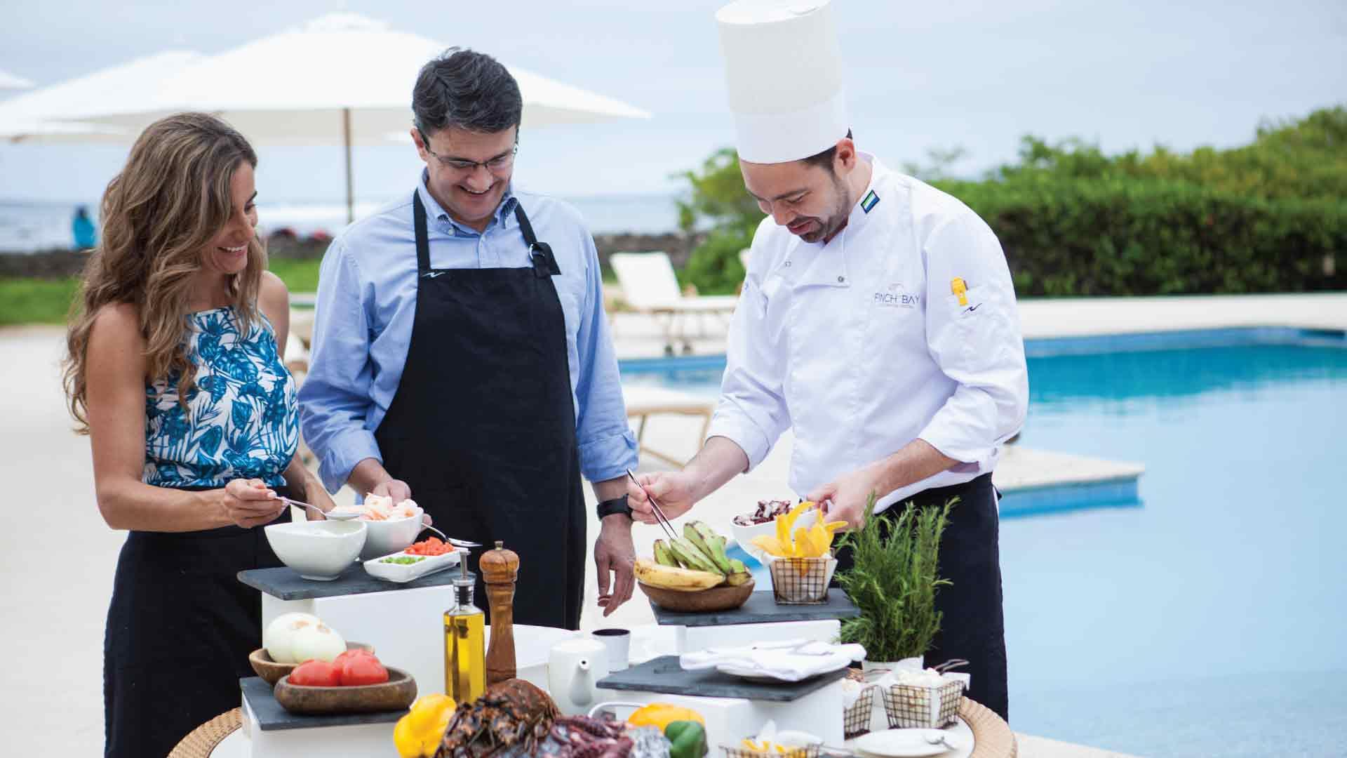 chef serving breakfast at finch bay hotel sant cruz iusland
