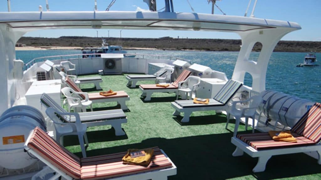 Angelito yacht Galapagos cruise - sundeck with loungers anf 360 degree Galapagos views