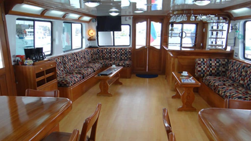 Angelito yacht Galapagos cruise - indoor social lounge area