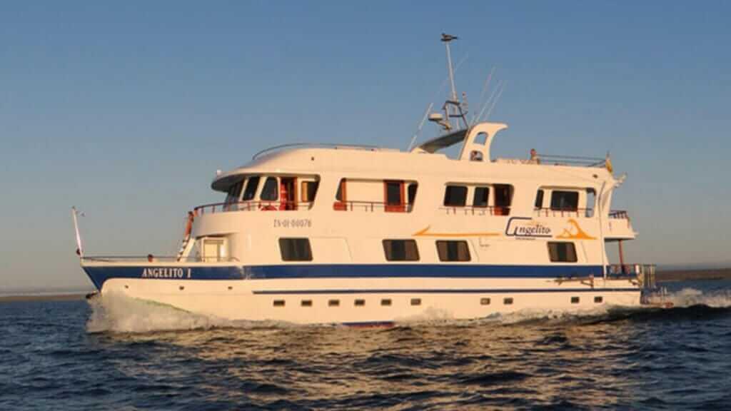 Angelito yacht Galapagos cruise - The Angelito illuminated by golden light at sunset