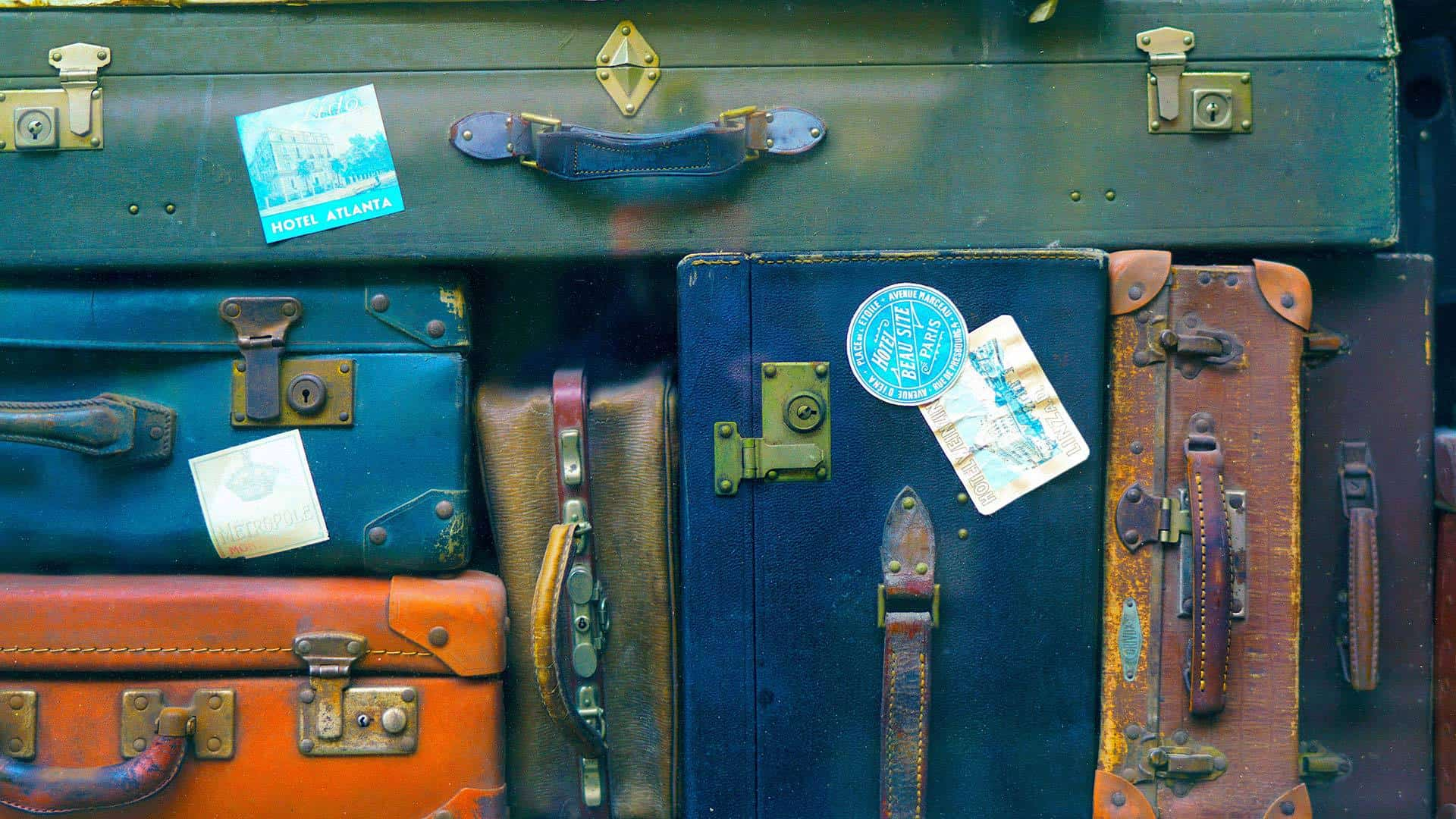 collage of vintage suitcases happy gringo blog