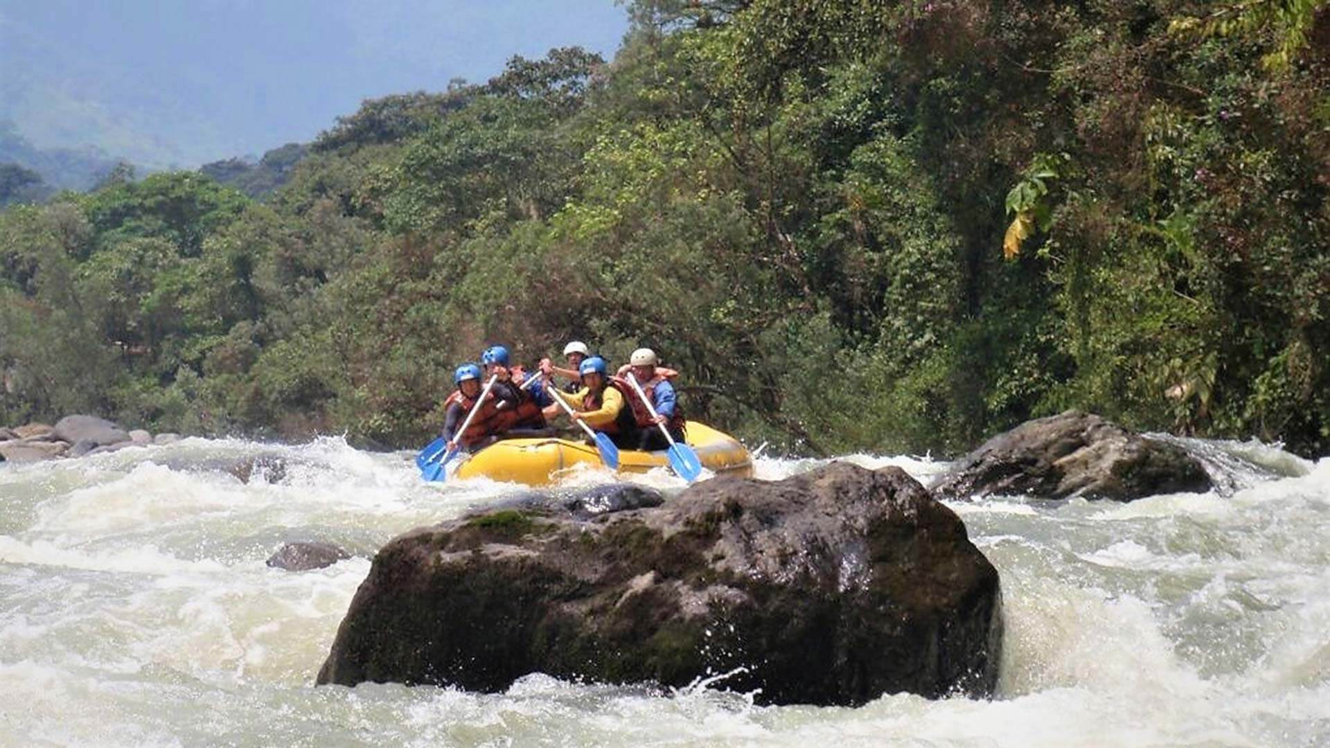 ecuador rafting tour in jungle rapids with rocks