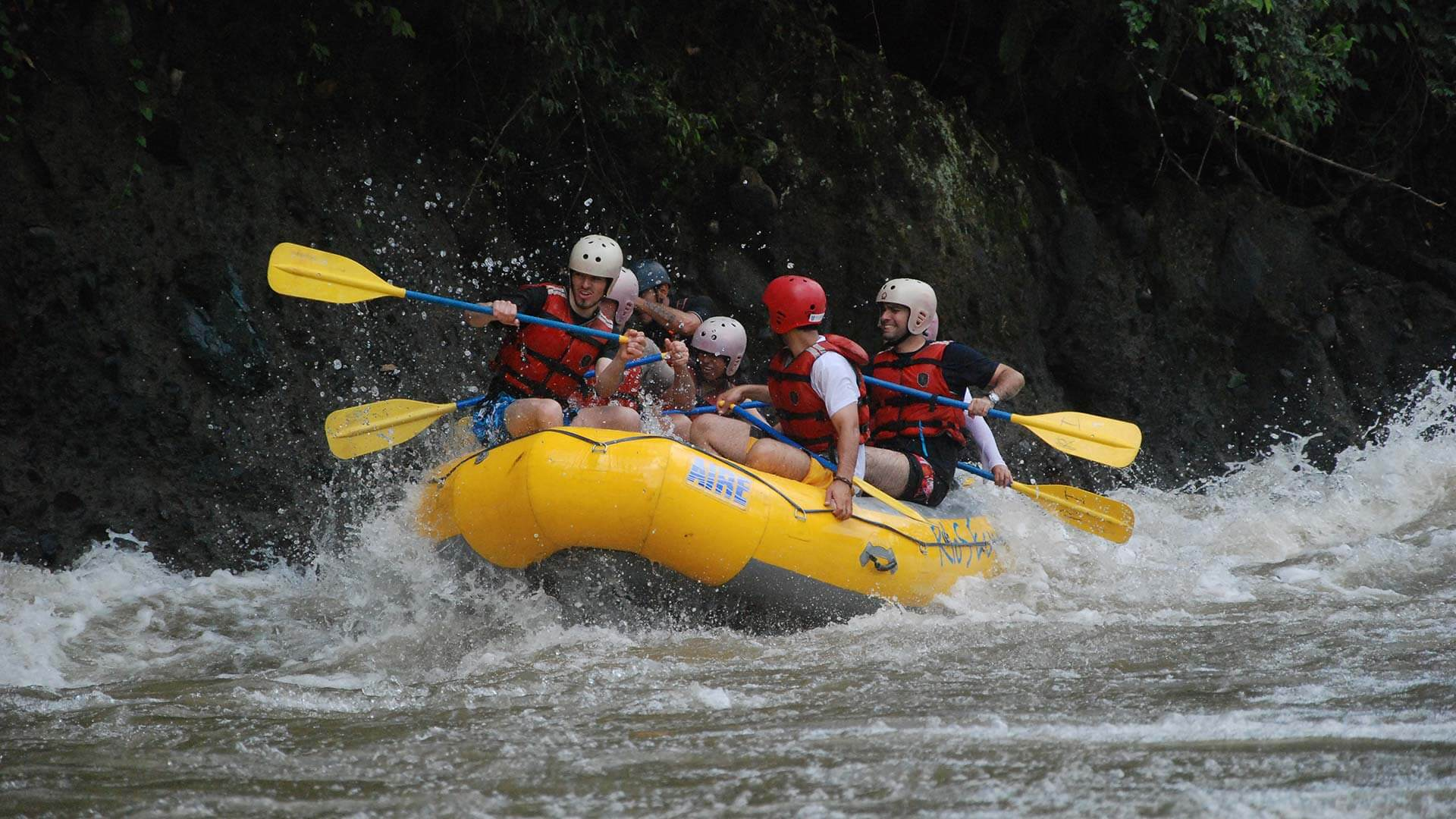 rafters paddle to control raft in ecuador