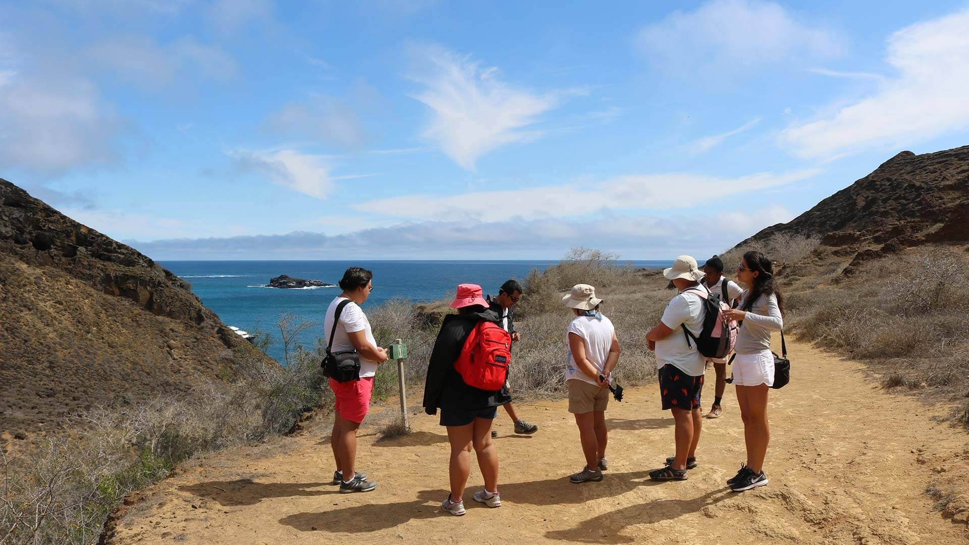 tourist group on guided trek at galapagos islands