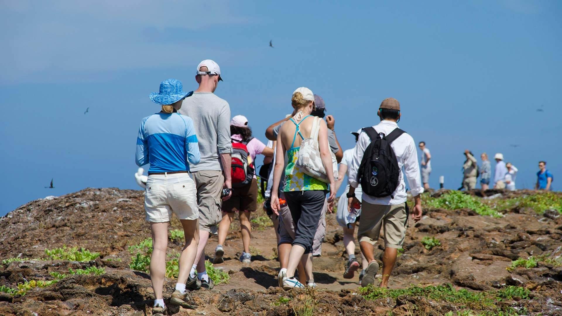 galapagos island hopping tourists walking in group