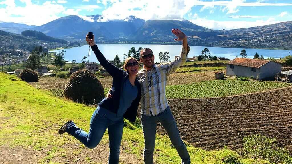 couple pose in front of lago san pablo lake otavalo ecuador