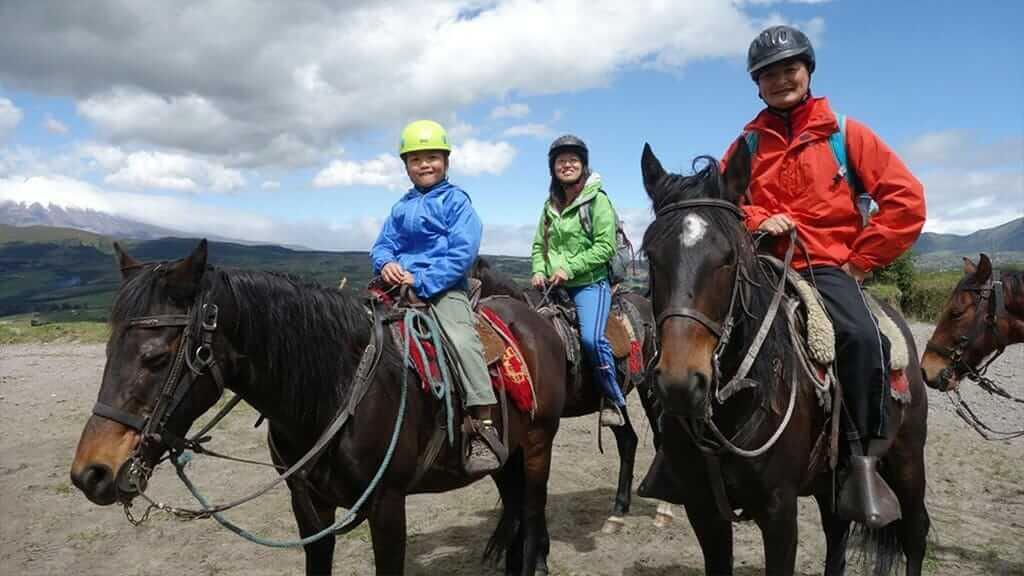 family enjoy an ecuador cloud forest horse riding tour