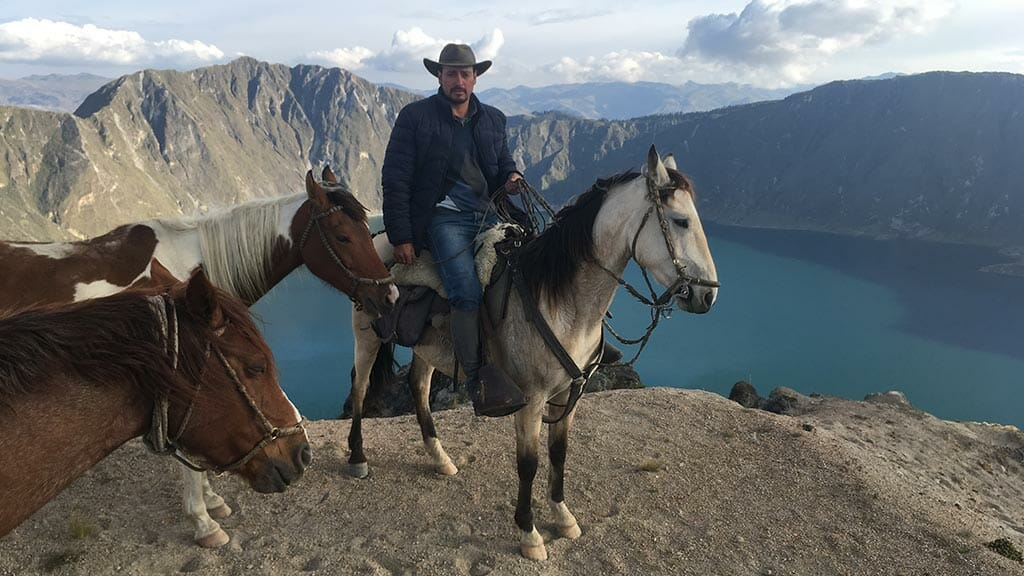 horse riding at quilotoa lagoon ecuador