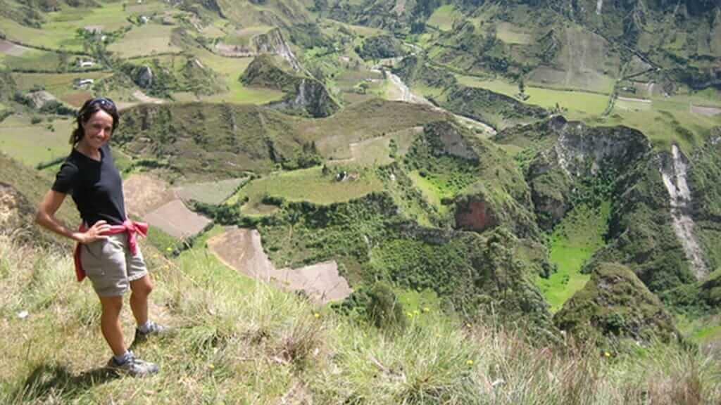tourist trekking chugchilan quilotoa loop with amazing green mountain views