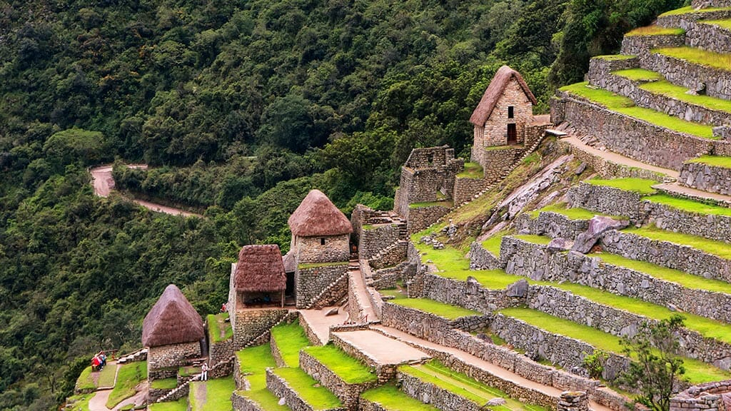 walled terraces and huts at machu picchu peru