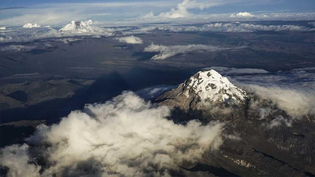 airplane view of ecuador snow capped volcanoes
