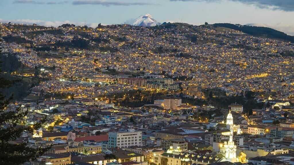 impressive landscape of quito's colonial center with cotopaxi volcano backdrop