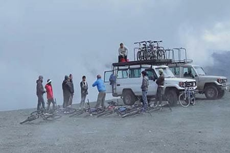 cotopaxi bikers high in the clouds