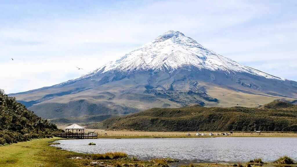 Limpiopungo Lake with majestic snow capped Cotopaxi Volcano backdrop, Ecuador