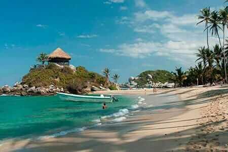 white sand beach and palm trees at Colombia Tayrona Caribbean Coast