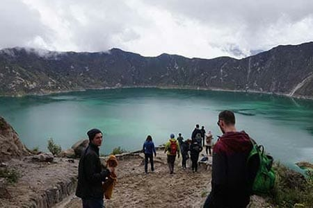 tourists trek into quilotoa crater ecuador