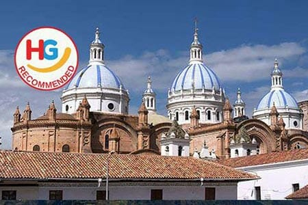 blue domes and red brick of cuenca cathedral ecuador