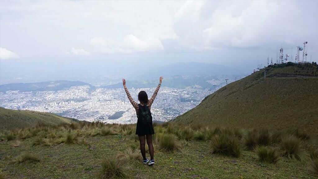 treker on pichincha volcano with views of quito city ecuador