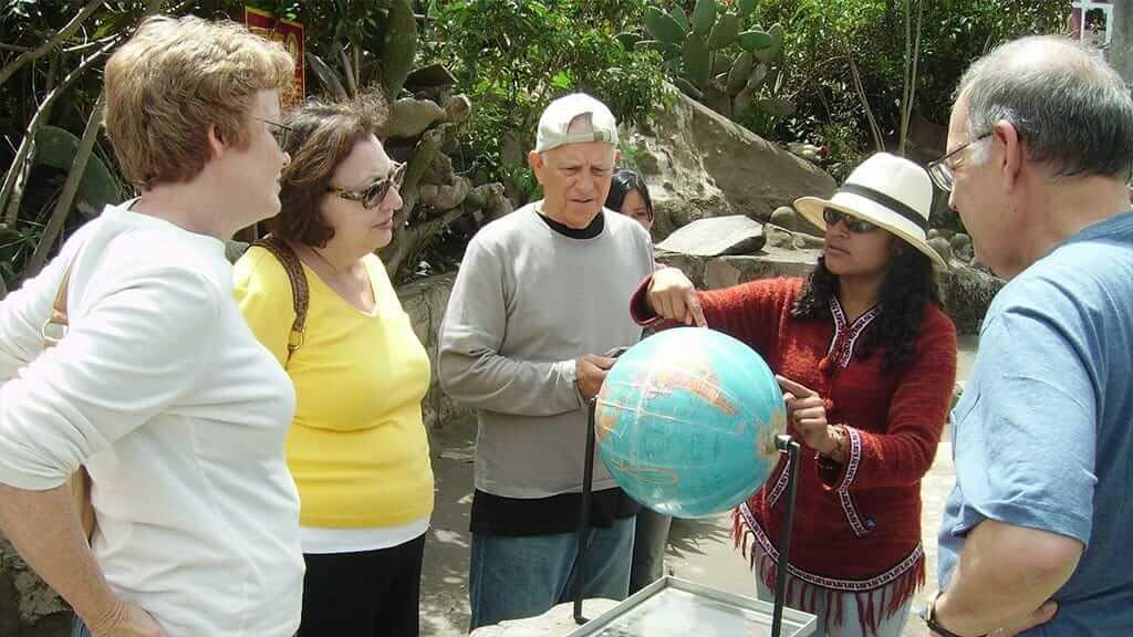 guide explaining science at the equator quito ecuador