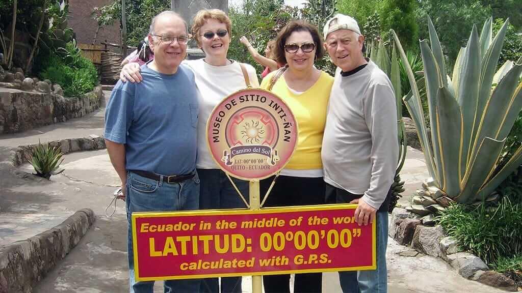 tourists pose at latitude zero on the equator line ecuador