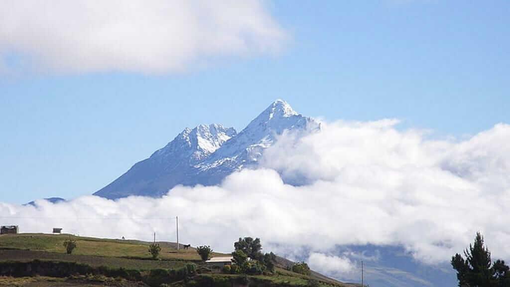 snow capped twin peaks of illinizas volcano ecuador