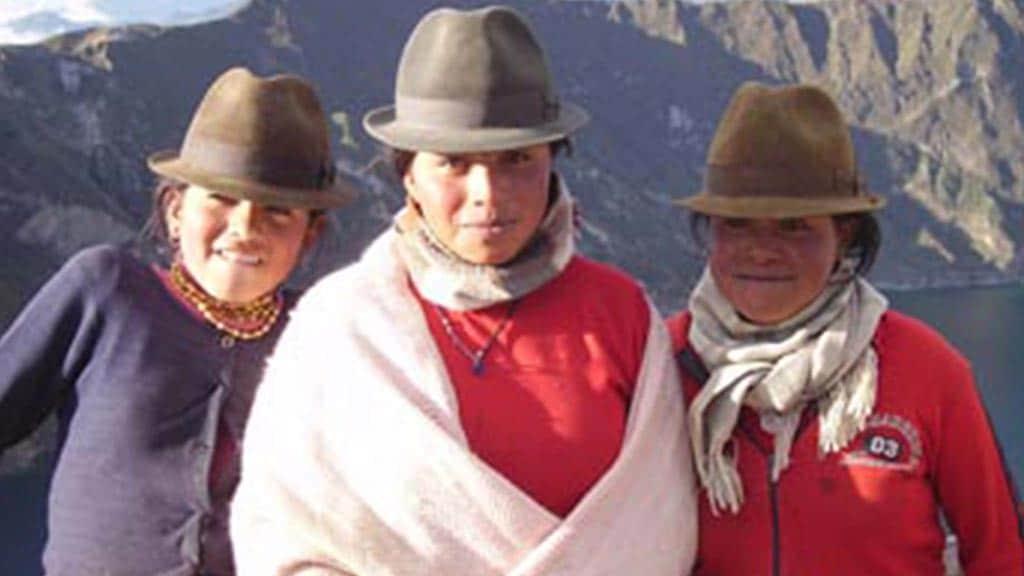 three indigenous women at quilotoa ecuador