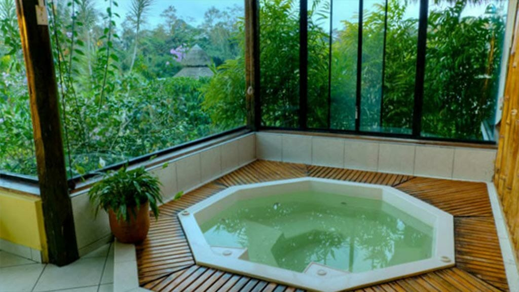 hot tub jacuzzi with forest view at arasha resort ecuador