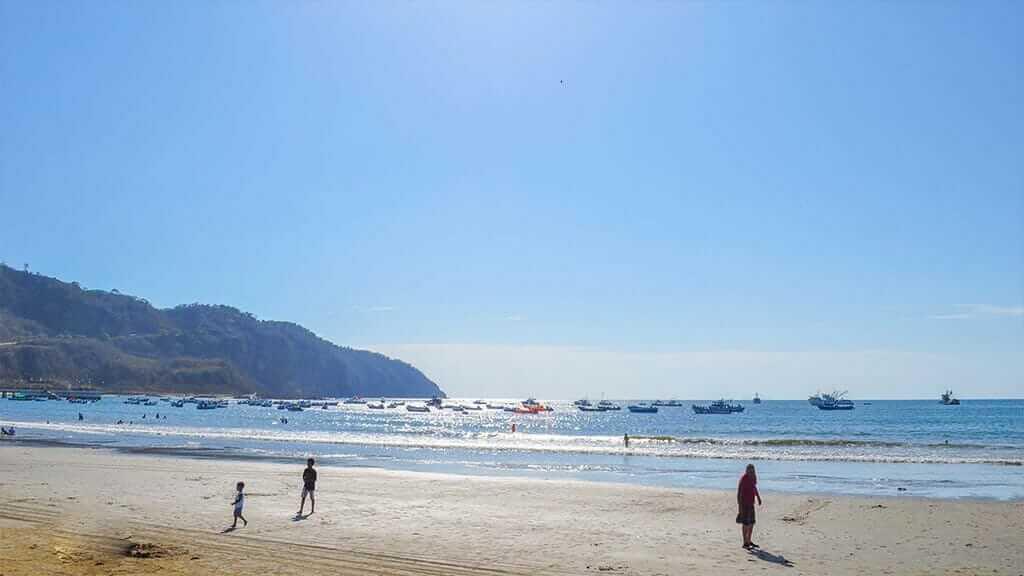 tourists on beach at machalilla ecuador