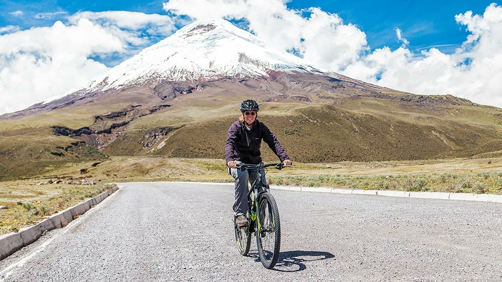 woman biking solo at cotopaxi volcano ecuador