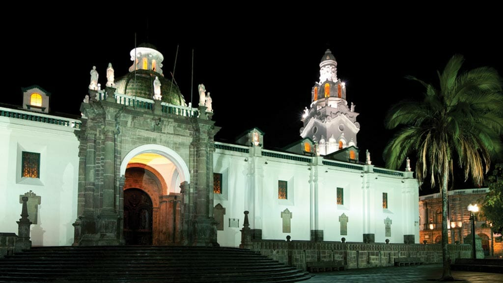 quito cathedral lit up at night