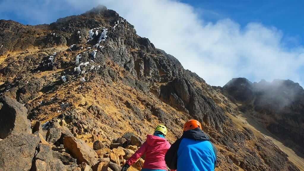 climbers reaching the peak of north illinizas volcano in ecuador