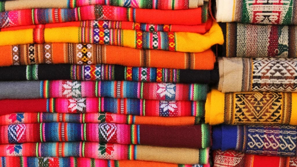 colorful fabrics for sale at otavalo market ecuador