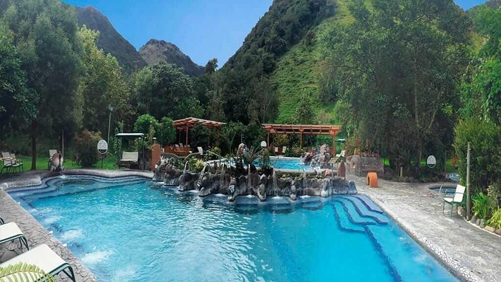 papallacta hot spring pools with green mountains in ecuador