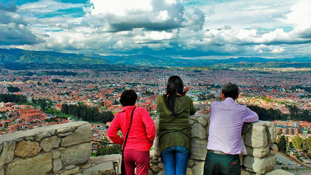 three tourists enjoy the views of cuenca ecuador from turi lookout