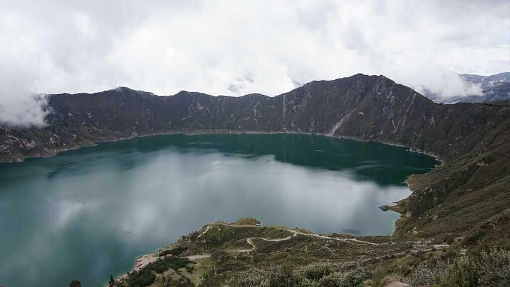 impressive landscape of lake inside quilotoa volcano crater