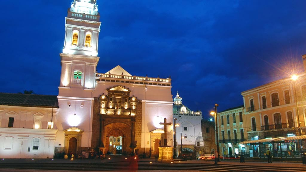 quito's santo domingo church lit up at night