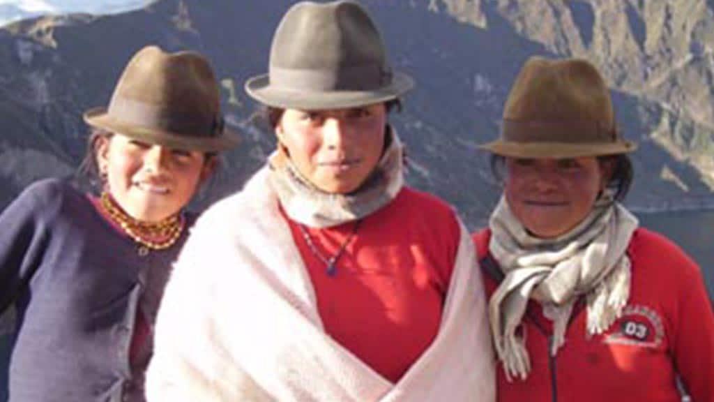 indigenous indian women at quilotoa lake