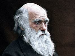 Portrait of Charles Darwin in old age with long white beard looking thoughtful