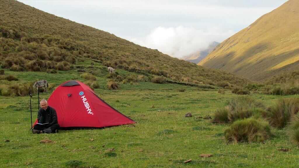 tourist camping with tent on ecuador inca trail trek