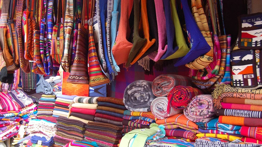 traditional-fabrics--ponchos-and-handbags-at-otavalo-market