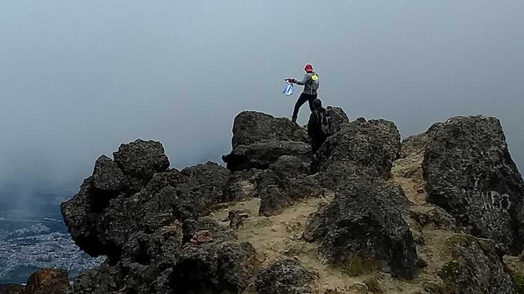 tourist on rucu pichincha volcano peak above quito