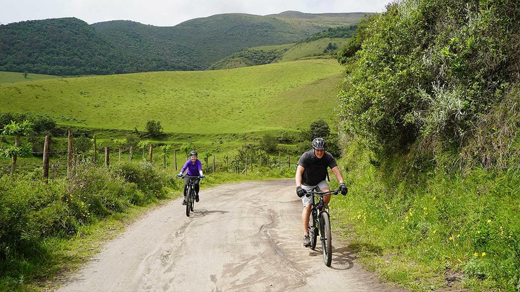 ecuador mountain biking with green rural mountain scenery
