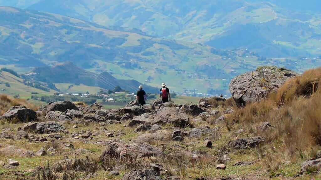two tourists pause to enjoy the view on the ecuador inca trail trek