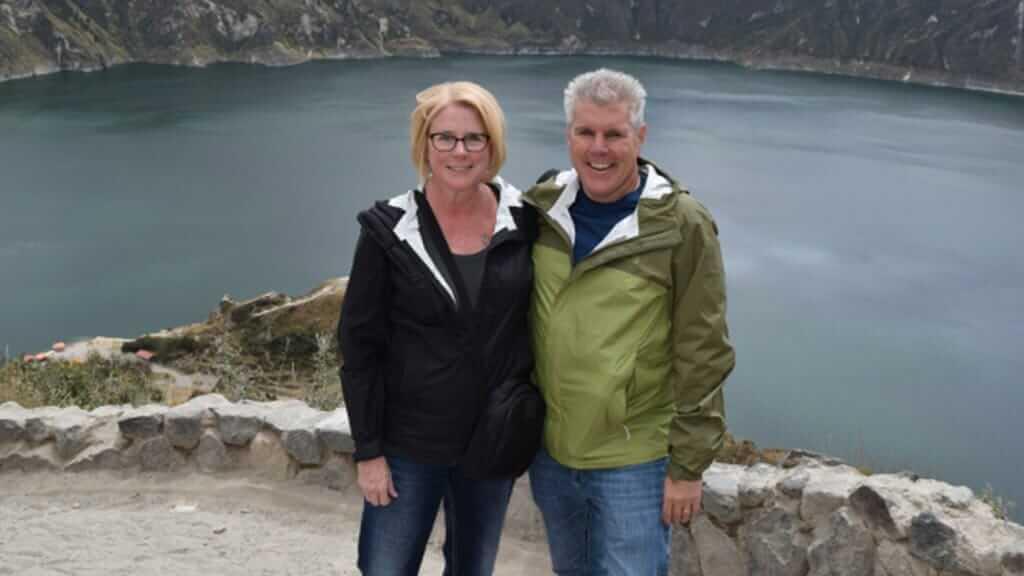 two tourists at quilotoa crater lake ecuador