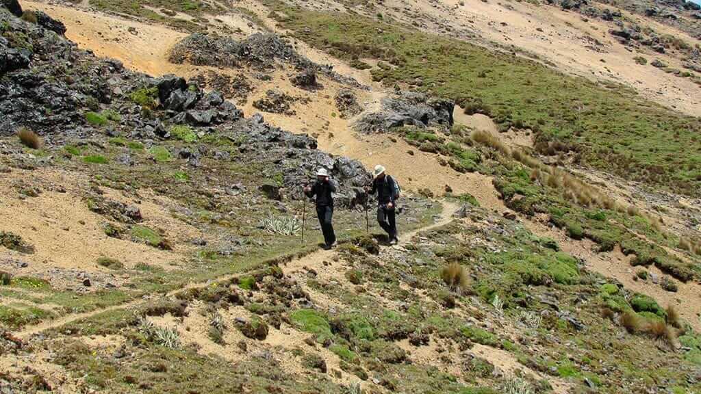 two tourists hiking ecuador's inca trail trek