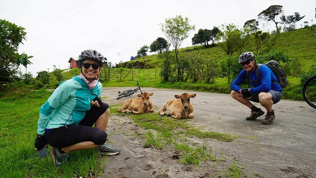 ecuador mountain bikers with 2 blonde baby calfs