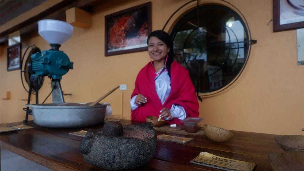 indigenous lady preparing ecuador coffee the traditional way