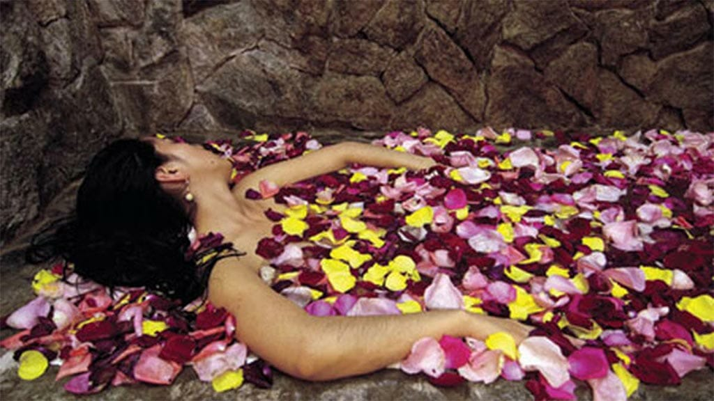woman-at-the-spa-cover-in-petals