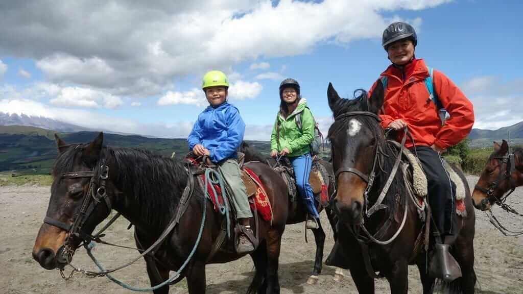 horse riders at quilotoa lagoon ecuador