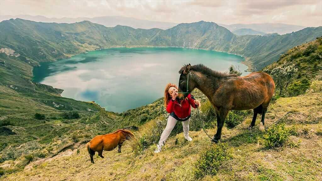 tourist with mules at quilotoa ecuador